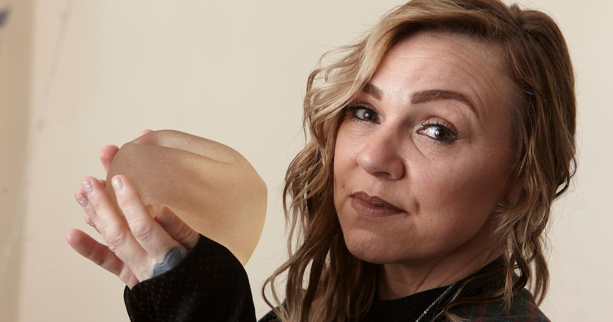Desperate mum tried to cut out her own breast implants
