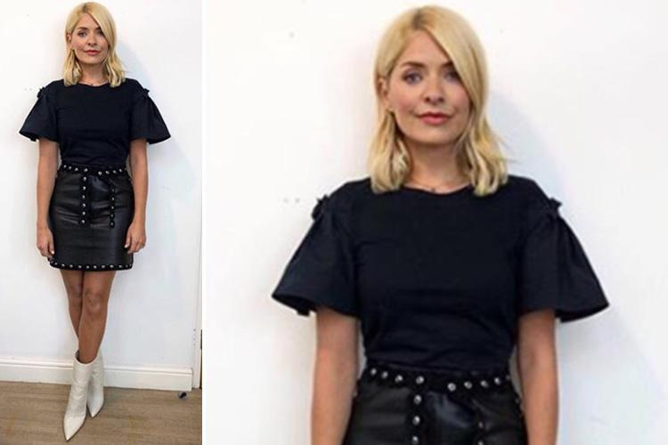 Holly Willoughby poses in a leather skirt and white boots and her fans go wild