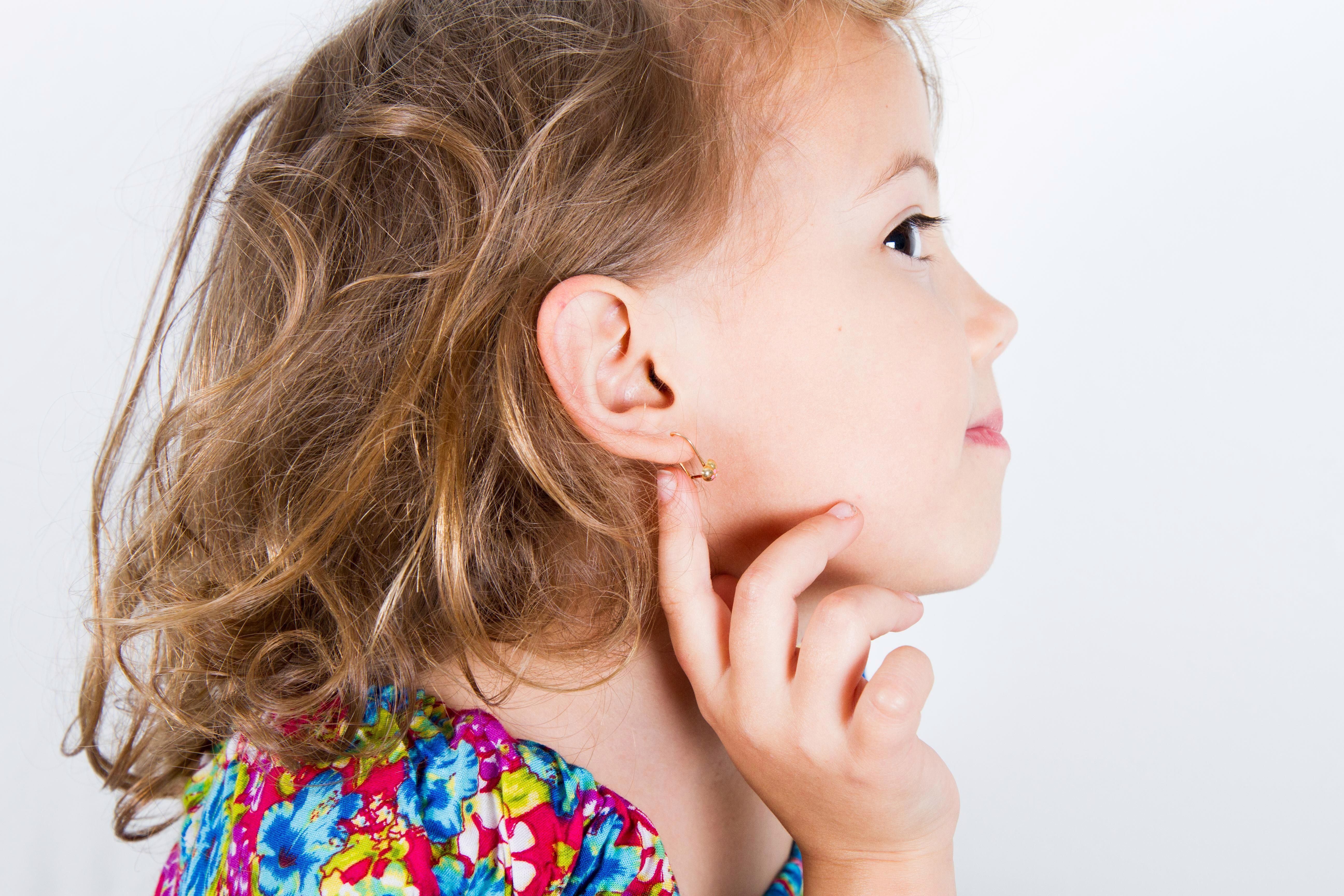 Mum sparks debate after asking if she should give in and let her daughter pierce her ears … at four years old