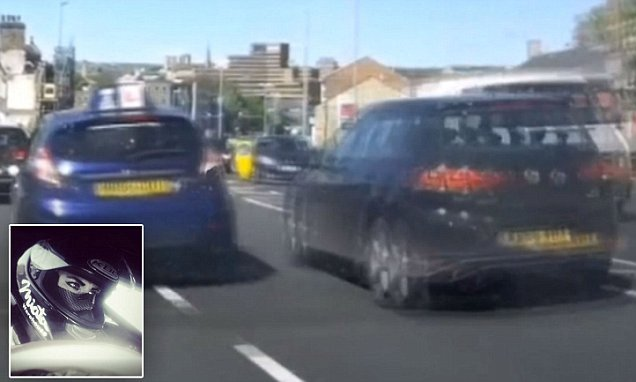Driving instructor swerves lanes when a car stops to turn at junction