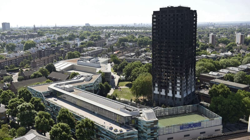 Father weeps for son at start of London's Grenfell Tower fire inquiry