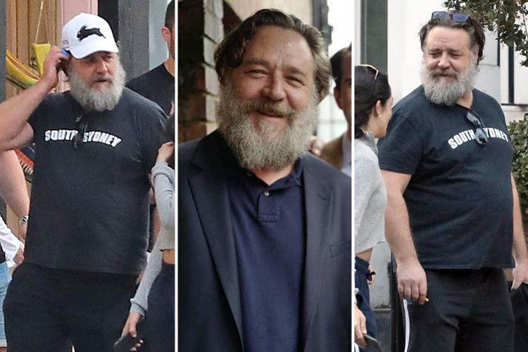 Russell Crowe, 54, looks unrecognisable as he strolls through London and smokes a cigarette