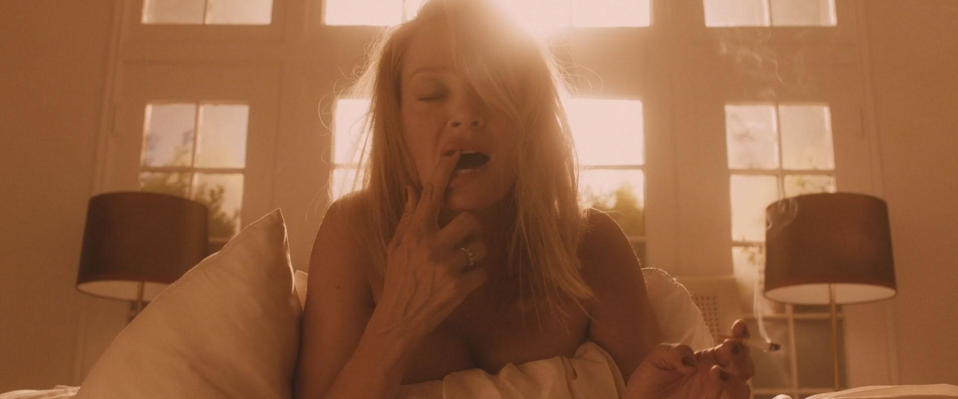 Uma Thurman goes topless for a sexy lesbian romp with Maggie Q in new movie The Con Is On