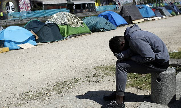 French government orders evacuation of Paris canal migrant camp