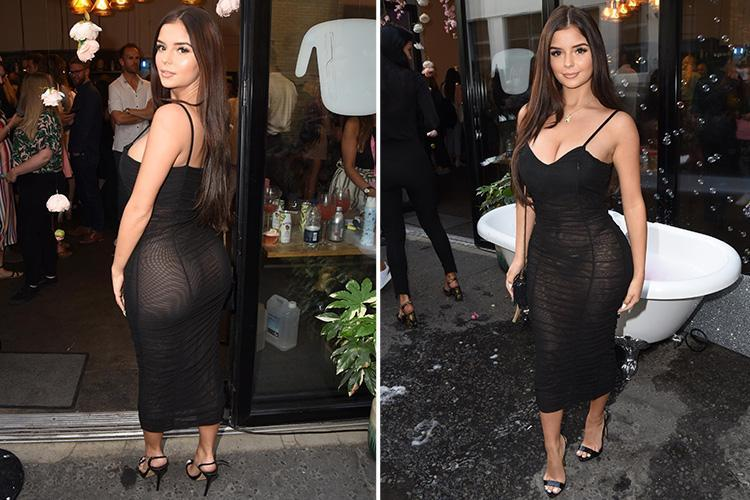 Demi Rose flashes her thong in a see-through dress at London fashion launch