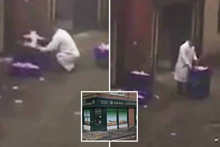 Moment butcher is 'caught chopping up chicken in dirty backstreet'