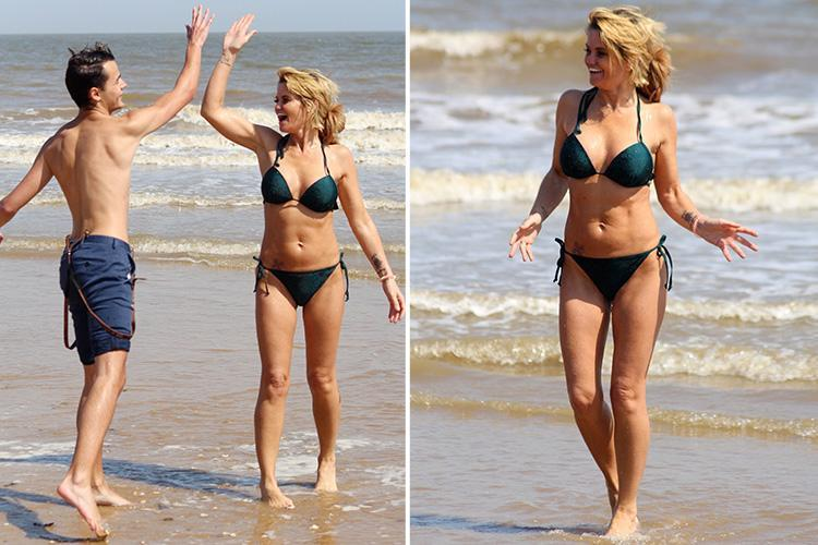 Danniella Westbrook frolics in the sea as she sizzles in the summer heatwave on a beach in Essex