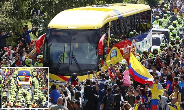 Colombian footballers arrive home flanked by police after threats