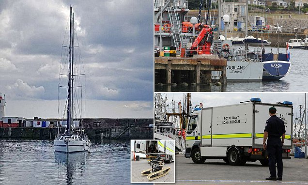 Police and bomb squad close harbour to storm yacht and arrest two men