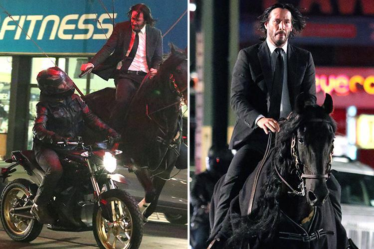 Keanu Reeves pulls a gun on a motorcyclist as he rides horseback through Brooklyn in a daring film stunt