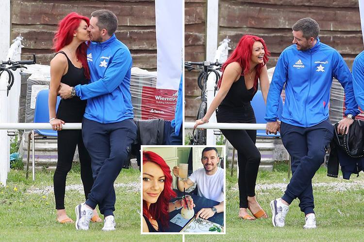 Emmerdale's Anthony Quinlan can't keep his hands off Strictly star girlfriend Dianne Buswell as they kiss at charity football match