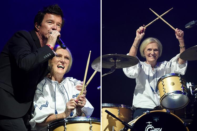 Mary Berry whips up a storm as she joins singer Rick Astley on stage and plays the drums