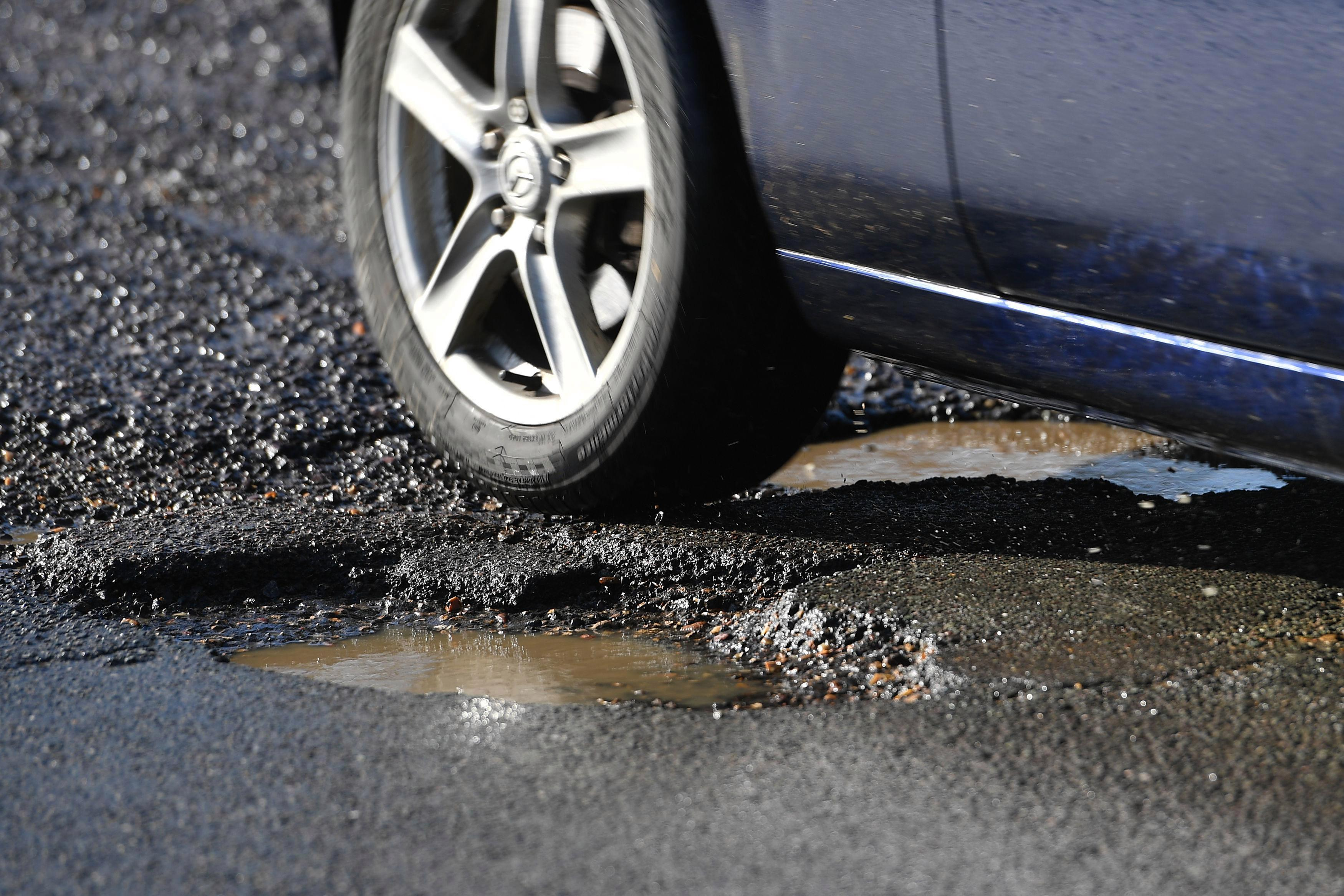 Theresa May told to ringfence part of £30bn from fuel duty to fix potholes