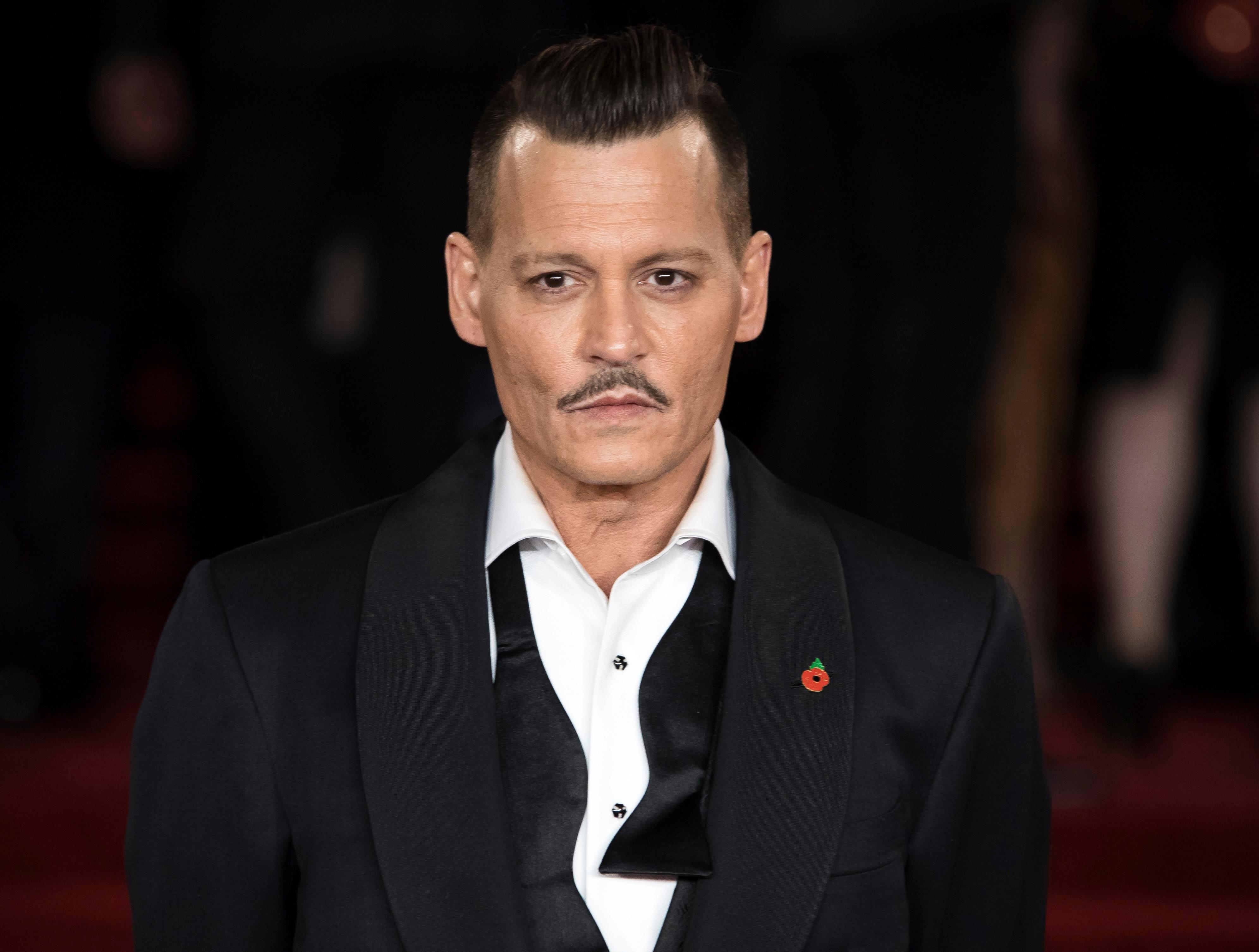 """Johnny Depp 'attacked crew member and screamed """"I'll give you $100k to punch me in the face"""" on Biggie Smalls set'"""