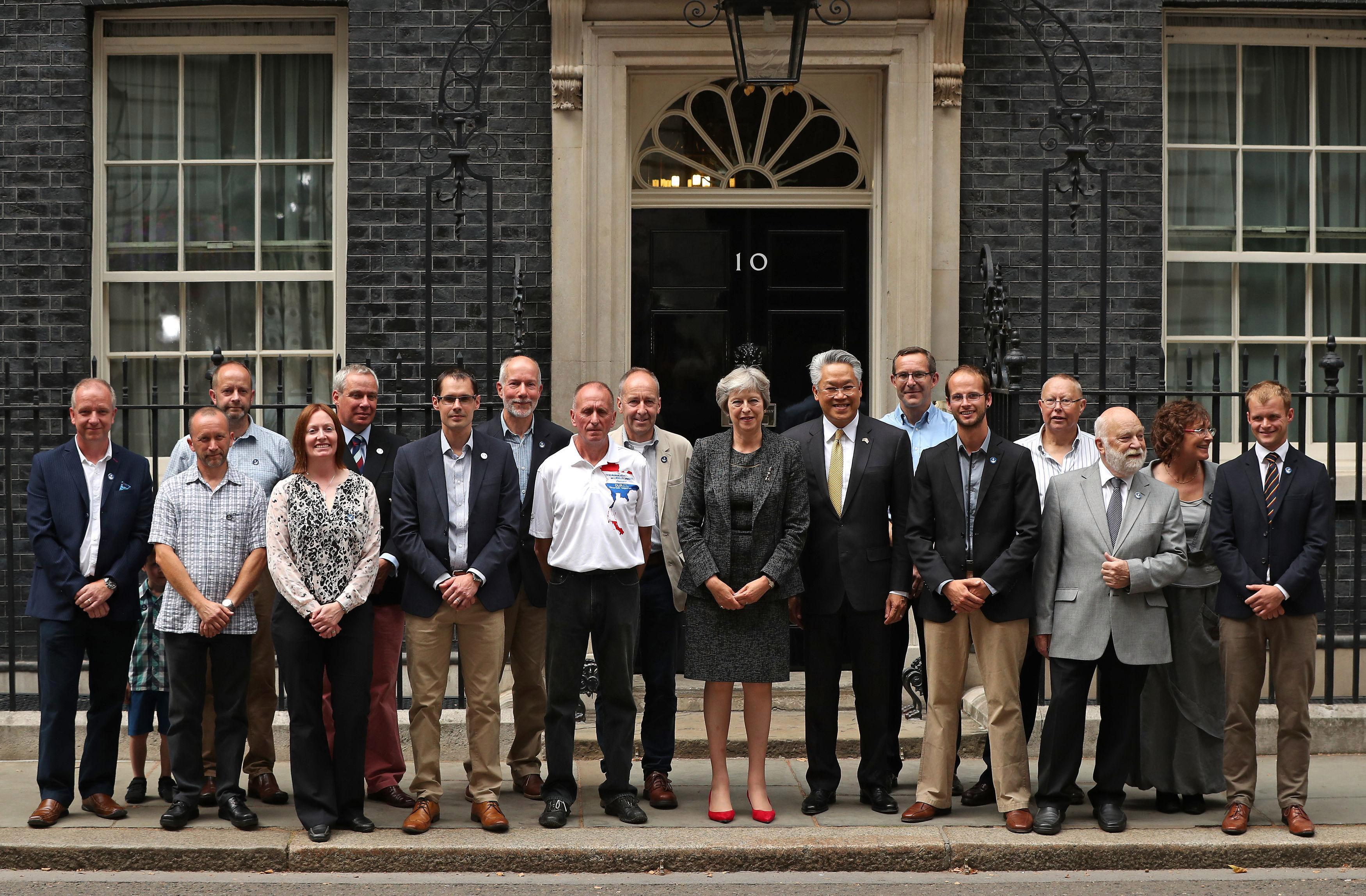 Theresa May hosts welcome party in Downing Street for British divers who saved Thai football boys from cave