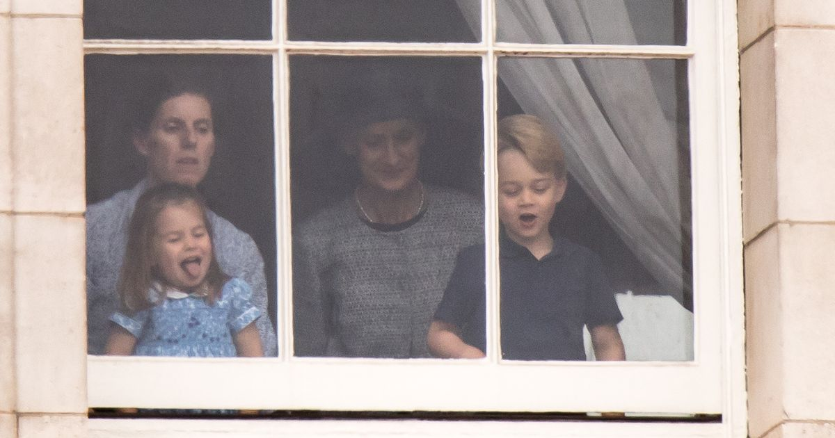 Cheeky Charlotte pokes tongue out as she peeks out of window to watch flypast