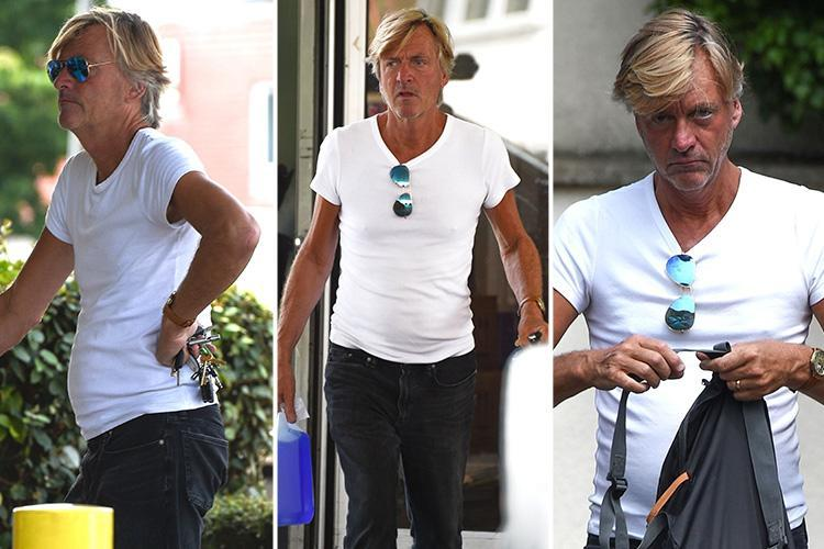 Richard Madeley soaks up the sun in a tight white t-shirt on a day out in London