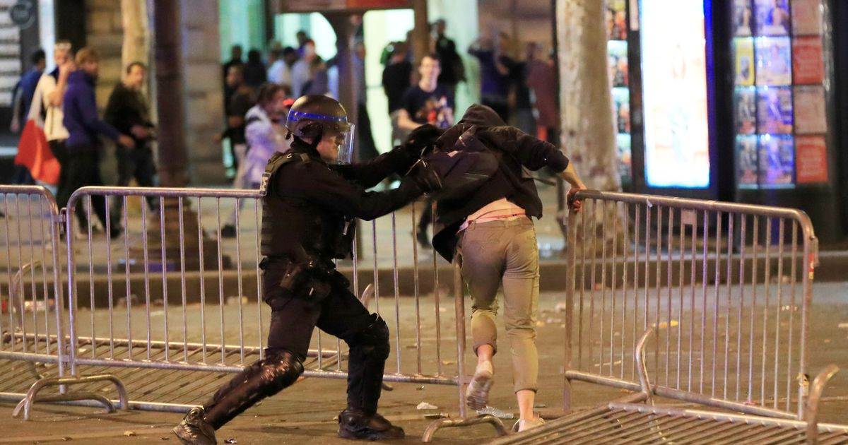 Fans clash with riot police in ugly scenes as France reach World Cup final