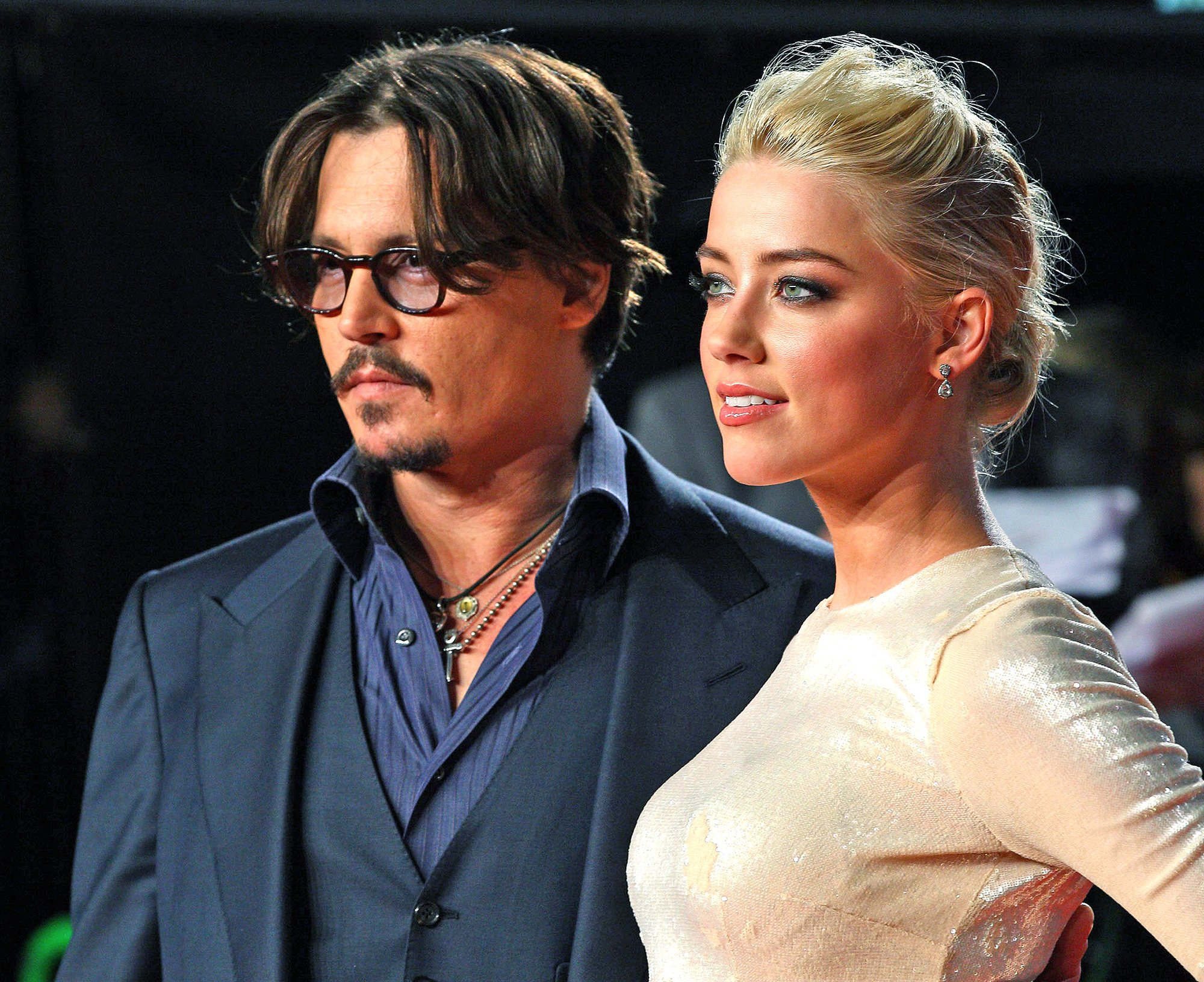 Johnny Depp Alters His Amber Heard Tattoo Again — This Time from 'Scum' to 'Scam'