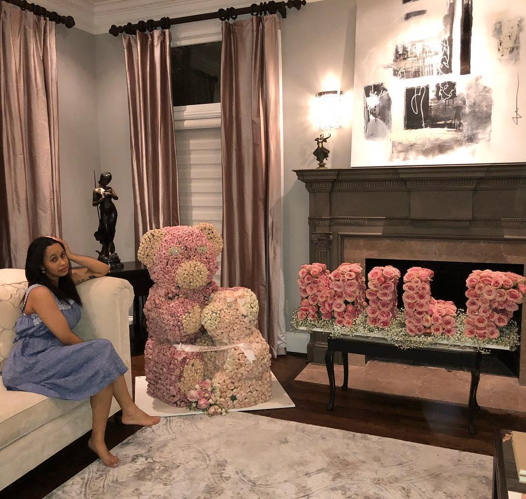 Cardi B gets huge 'MILF' flower arrangement one week after giving birth – but she doesn't look happy about it