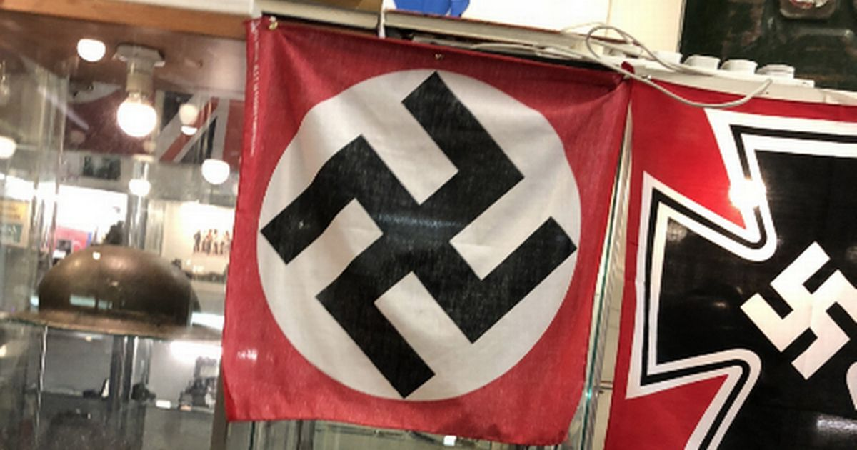 Shoppers stunned as man in 'German army uniform' sells Nazi flags at market