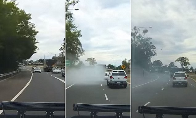 Car disappears in a cloud of smoke on Australian road