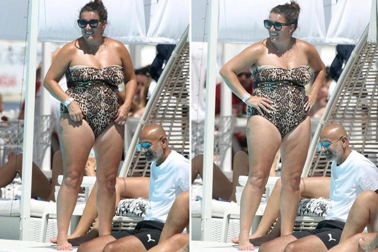 Sam Bailey shows off her wild side as she tops up her tan in a leopard print swimsuit poolside in Ibiza