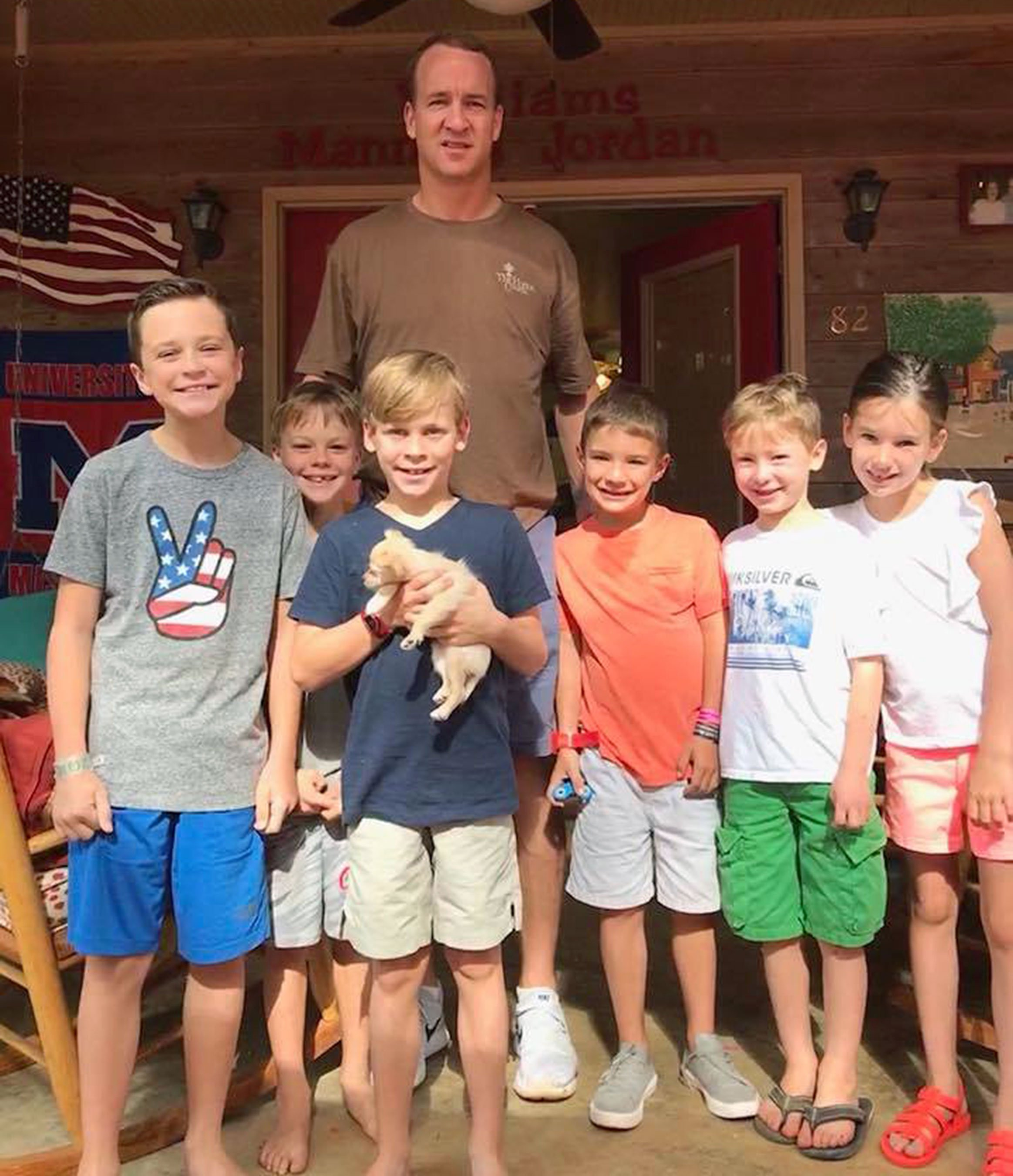 One Lucky Dog: Peyton Manning Adopts Abused Puppy After Family Falls for Her on Vacation