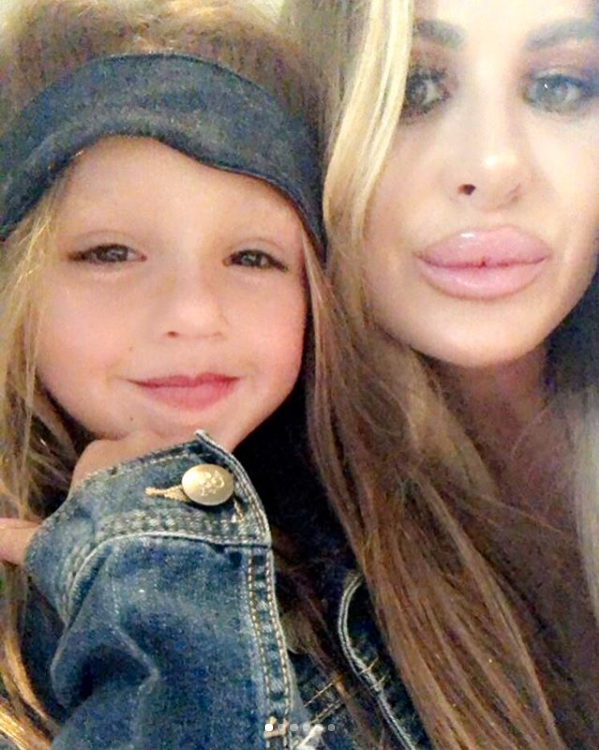 Kim Zolciak-Biermann Claps Back at Negative Comments About Her Enhanced Lips: 'I Love Them'