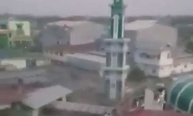 Terrifying moment people flee as tsunami wave smashes mosque