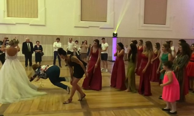 Painful moment drunken uninvited guest faceplants during bouquet toss