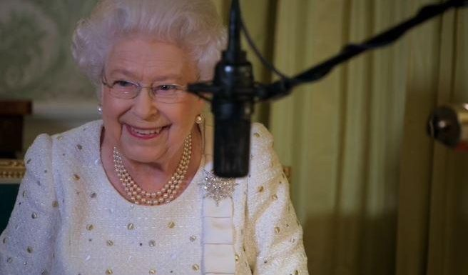 This is the endearing moment the Queen giggles as nervous TV crew member asks her to reread the Christmas speech ruined by a BIRD
