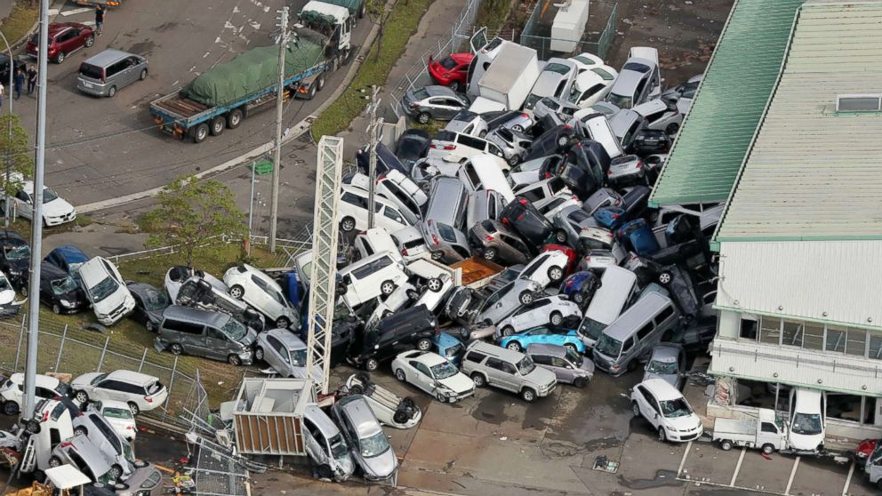 Dramatic photos reveal chaotic aftermath of typhoon in Japan