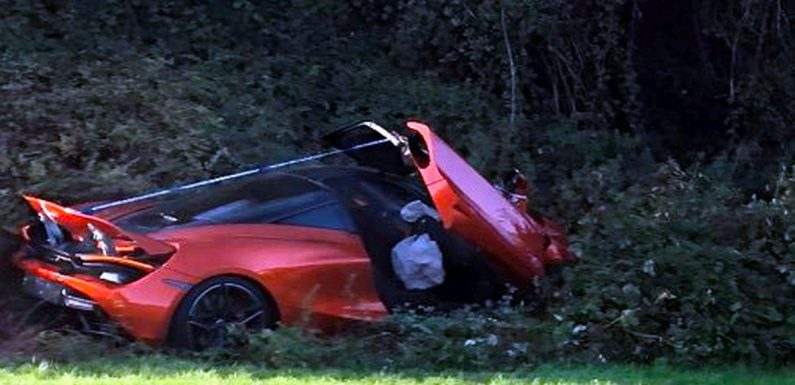 Crumpled supercar worth around £250,000 buried in bushes on busy roundabout