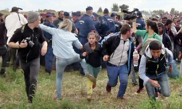 Hungarian camerawoman who was seen tripping refugees is CLEARED