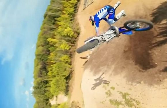 Drone footage shows motocross freestyle rider performing stunts