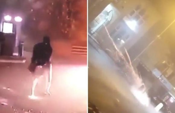 Shocking footage shows yobs setting roads alight and shooting fireworks at pub in 'war zone' Bradford
