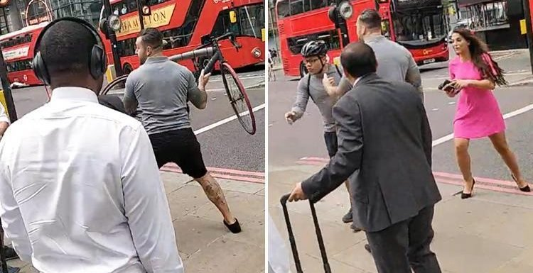 Moment 'tough guy' thug attacks cyclist half his size on busy London street hurling his bike at him 'to impress his girlfriend'