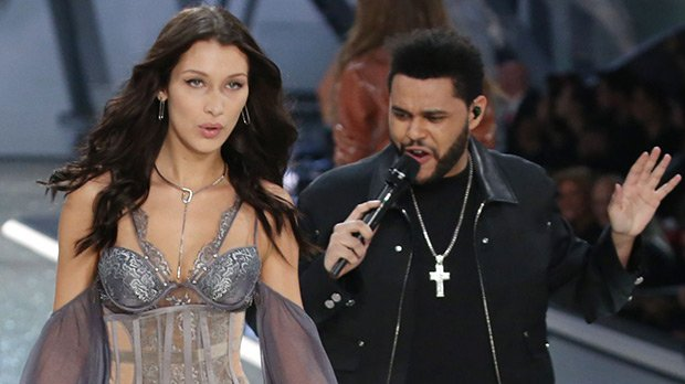 The Weeknd Proudly Supports Bella Hadid At VS Fashion Show & Sits With Her Mom