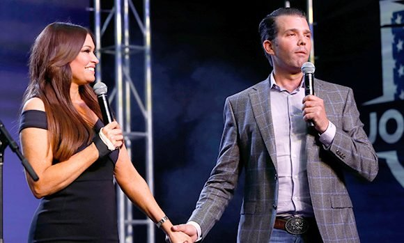 Donald Trump Jr. & GF Kimberly Guilfoyle Put Their Arms Around Each Other At NYC Holiday Party — Pics