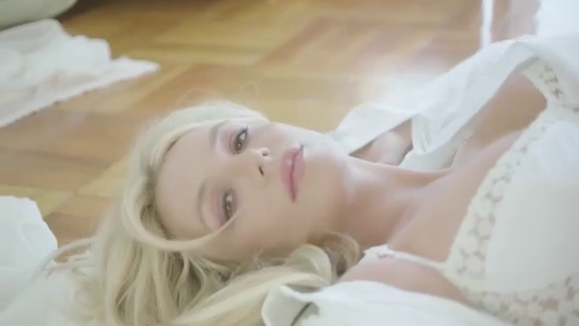Britney Spears reveals her enviable figure in a white bra for latest perfume ad