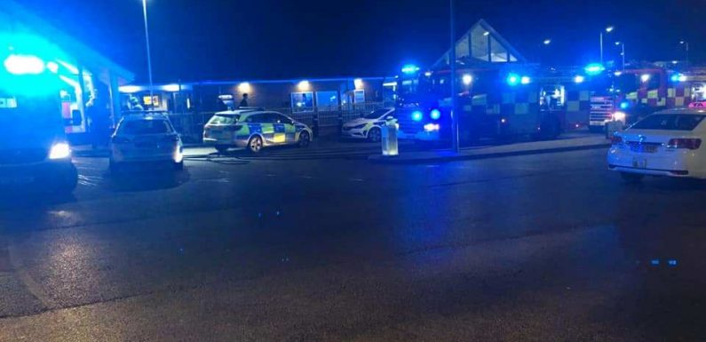 Teen, 17, arrested after four men had 'unknown substance thrown in their face' outside shopping centre
