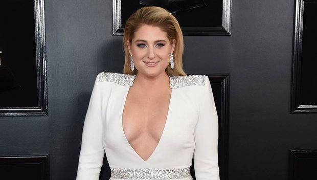 Meghan Trainor Stuns In A Bridal White Plunging Jumpsuit At The Grammys With Daryl Sabara