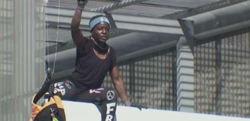 Statue of Liberty climber scales Texas building in immigration protest