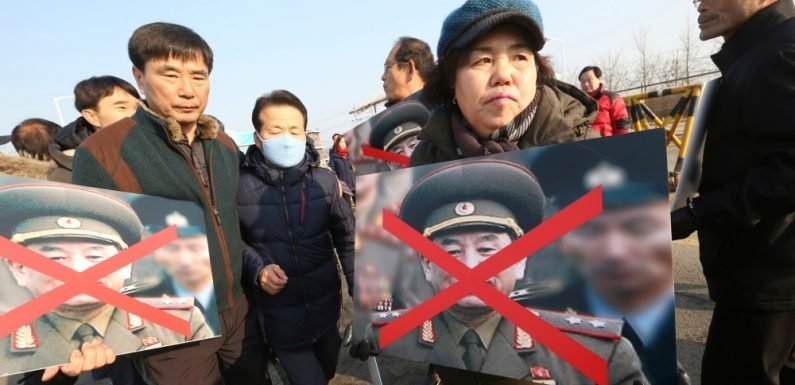 N Korea delegates arrive in South for Olympics closing ceremony