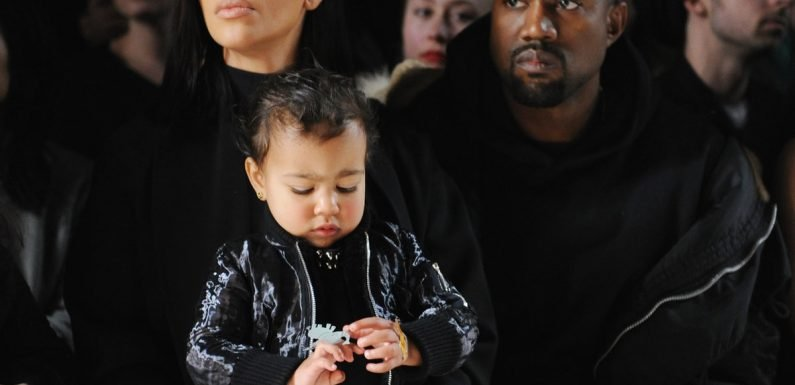 Kim Kardashian's Photo With Kanye West & Their Kids Features A Relatable Parent Struggle