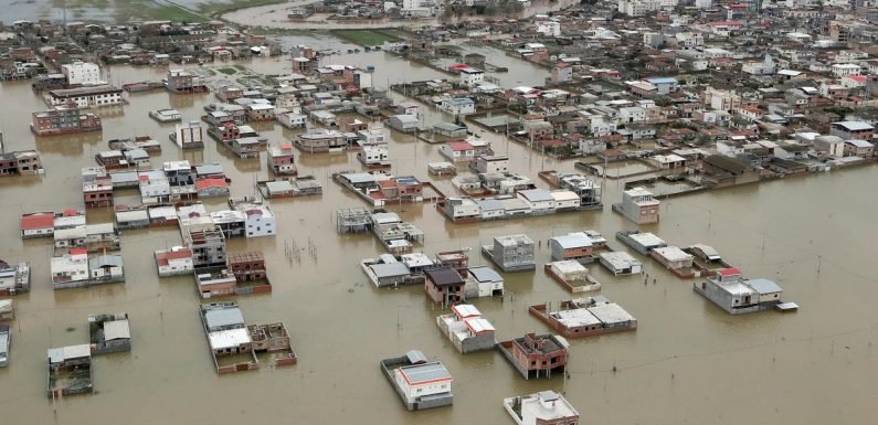 Iran evacuates flood-threatened villages after heavy rains kill dozens