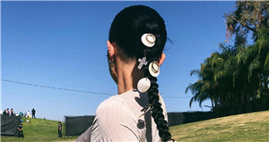 These Hair Charms For Braids & Beyond Will Make Your Stands Look Extra Magical