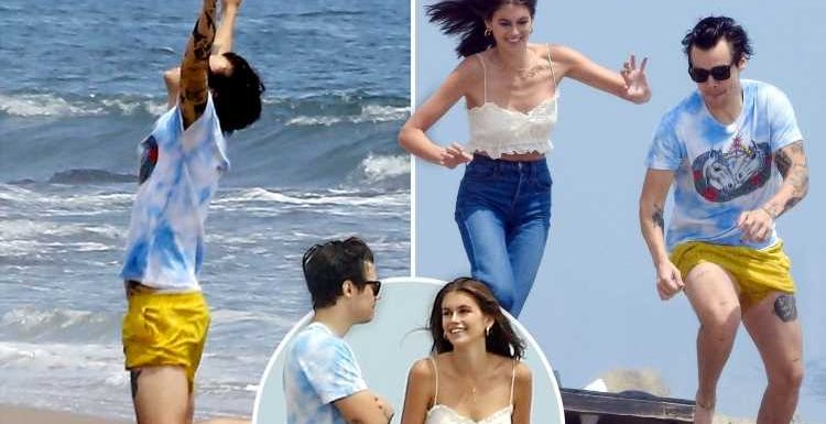 Harry Styles wears tiny yellow shorts as he plays American football with Cindy Crawford's daughter Kaia Gerber, 17, on the beach in Malibu