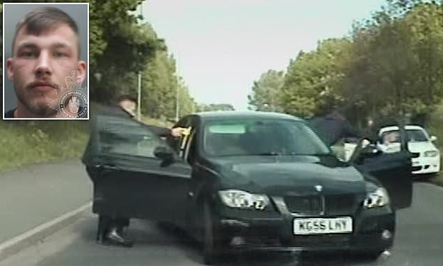 Banned driver who reversed into police is jailed for more than a year